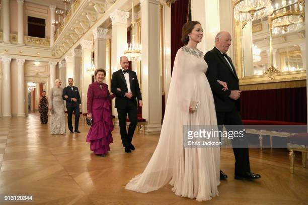 Catherine Duchess of Cambridge is escorted into dinner by King Harald V of Norway and Prince William Duke of Cambridge is ecorted by Queen Sonja of...