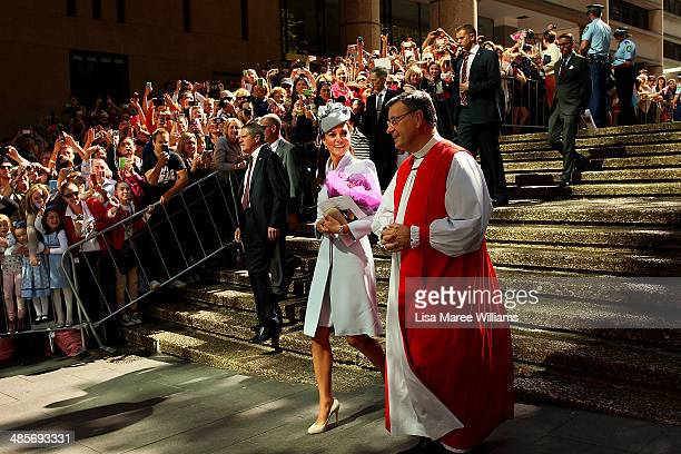 Catherine Duchess of Cambridge is escorted past awaiting fans following Easter Sunday Service at St Andrews Cathedral on April 20 2014 in Sydney...