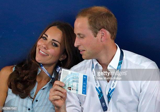 Catherine Duchess of Cambridge is fanned by Prince William Duke of Cambridge as they watch the swimming at the Tollcross International Swimming...