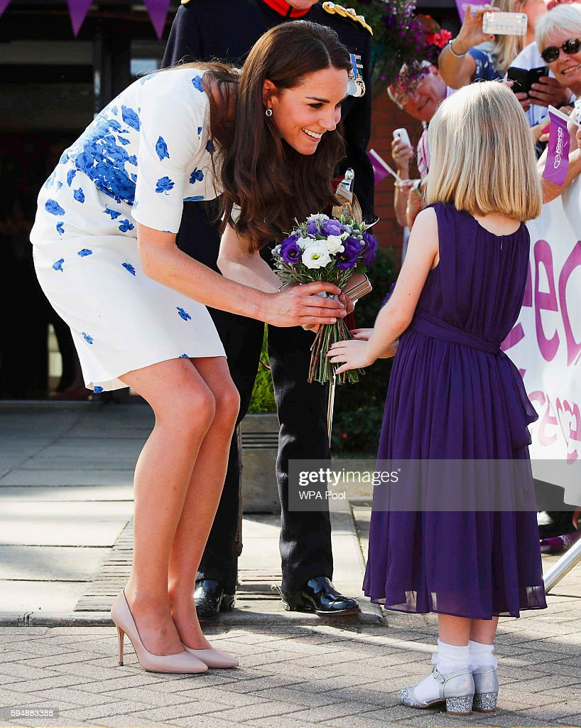 Catherine, Duchess of Cambridge is given flowers by Evie Farmer during a visit to Keech Hospice Care on August 24, 2016 in Luton, England. The Duke and Duchess visited Youthscape at Bute Mills to tour the facility and learn about Youthscape's work, and then meet CHUMS and the OM Group and Luton Council of Faiths and Grassroots for discussions about coping with suicide and supporting young people's mental health and emotional wellbeing across faith groups.