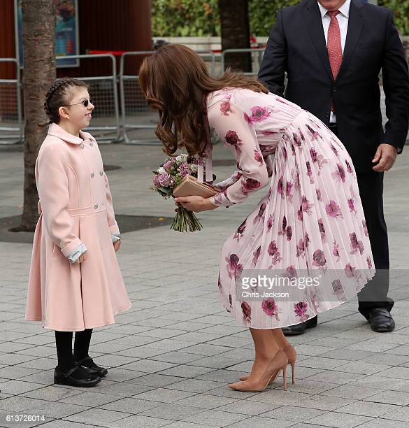 Catherine Duchess of Cambridge is greeted by a member of the public as she attends the World Mental Health Day celebration with Heads Together at the...