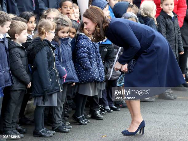 Catherine, Duchess of Cambridge is greeted by children as she visits the Reach Academy with Place2Be on January 10, 2018 in London, England. The...