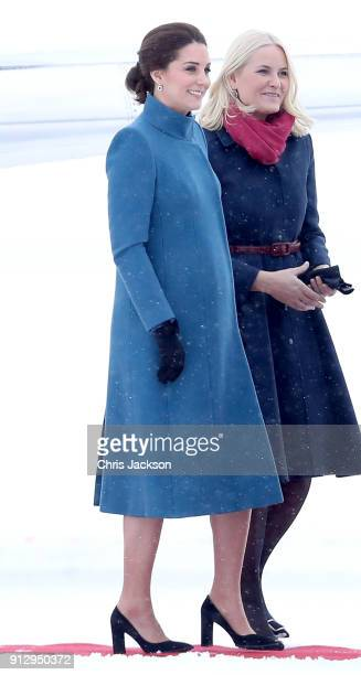 Catherine Duchess of Cambridge is greeted by Crown Princess MetteMarit of Norway as she arrives to Oslo Gardermoen Airport on day 3 of her visit to...