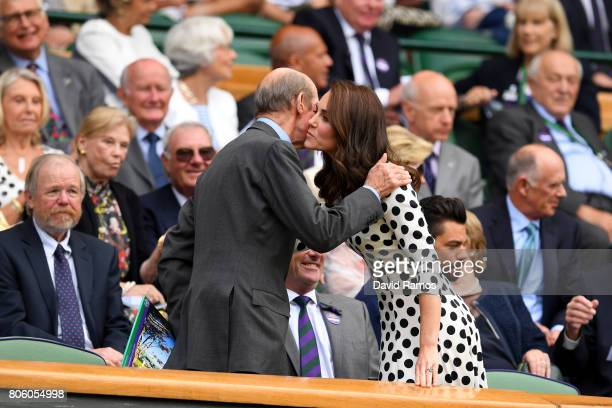 Catherine Duchess of Cambridge is greeted by HRH The Duke of Kent on centre court on day one of the Wimbledon Lawn Tennis Championships at the All...