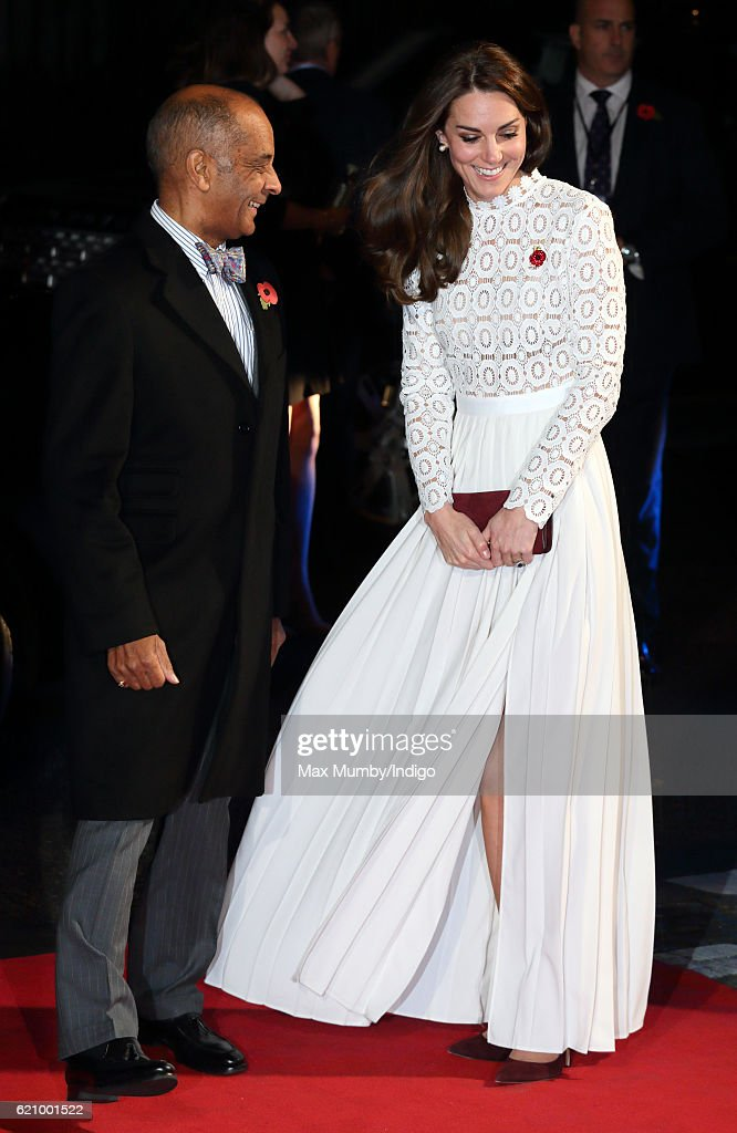 Catherine, Duchess of Cambridge, is greeted by the Lord-Lieutenant of London Kenneth Olisa as she attends the UK Premiere of 'A Street Cat Named Bob' in aid of Action On Addiction at The Curzon Mayfair on November 3, 2016 in London, England.