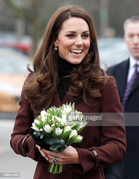 Catherine Duchess of Cambridge is greeted by wellwishers as she visits Alder Hey Children's Hospital on February 14 2012 in Liverpool England...