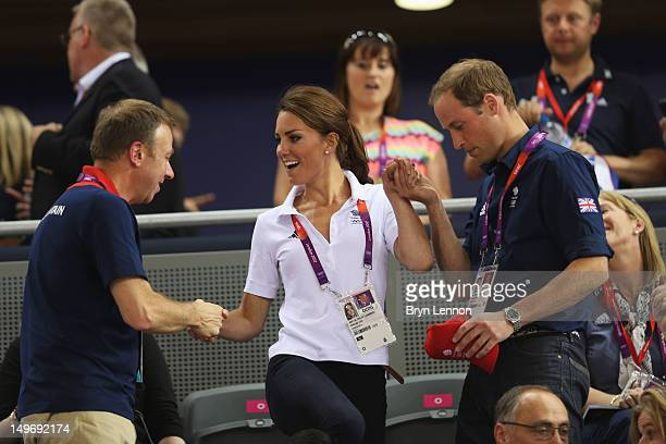 Catherine Duchess of Cambridge is helped to her seat by Prince William Duke of Cambridge and Andy Hunt Chef de Mission for Great Britain as they...