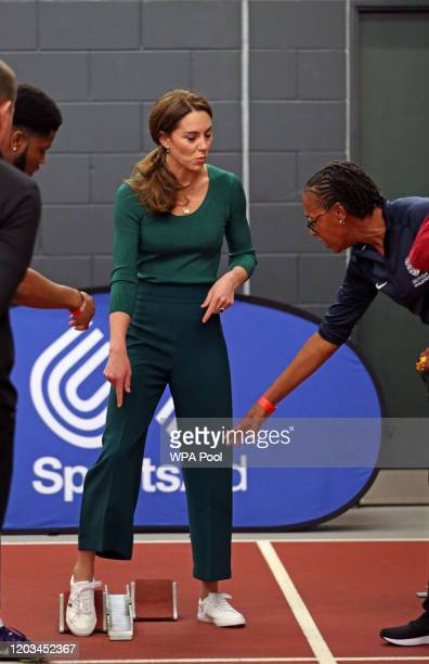 Catherine, Duchess of Cambridge is instructed how to use starting blocks during a SportsAid Stars event at the London Stadium in Stratford on...