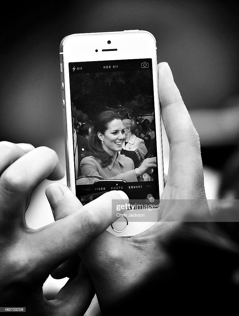 Catherine, Duchess of Cambridge is pictured through the screen of a mobile phone as she meets the gathered crowds in Seymour Square during Day 4 of a Royal Tour to New Zealand on April 10, 2014 in Blenheim, New Zealand. The Duke and Duchess of Cambridge are on a three-week tour of Australia and New Zealand, the first official trip overseas with their son, Prince George of Cambridge.