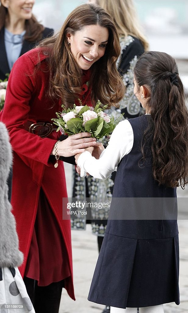 Catherine, Duchess of Cambridge is presented with a bouquet of flowers as she arrives for a visit to the UNICEF Emergency Supply Centre on November 2, 2011 in Copenhagen, Denmark. Catherine, Duchess of Cambridge and Prince William, Duke of Cambridge visited the centre to view efforts to distribute emergency food and medical supplies to eastern Africa where severe food shortages are affecting more than 13 million people.