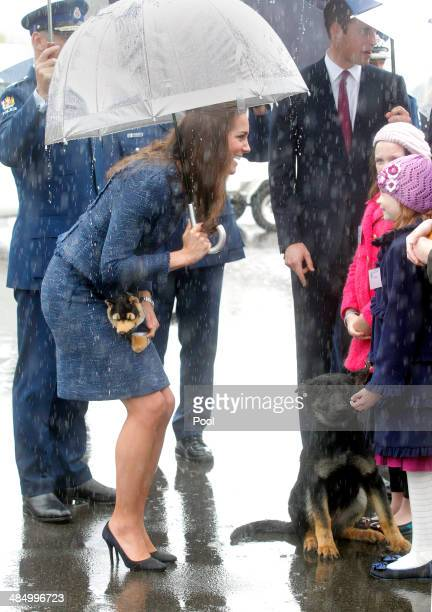 Catherine Duchess of Cambridge is presented with a toy police dog by Monet Bole aged eight during a visit to the Royal New Zealand Police College on...