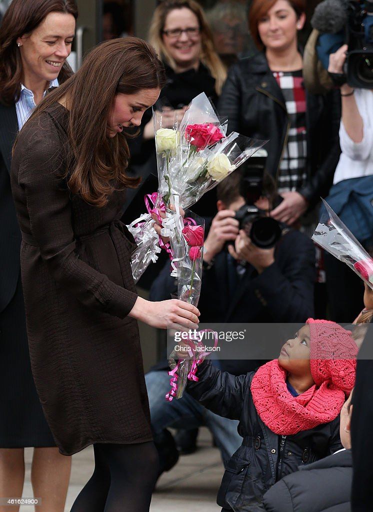 Catherine, Duchess of Cambridge is presented with flowers by a young child as she leaves an event hosted by The Fostering Network to celebrate the work of foster carers in providing support to vulnerable young people on January 16, 2015 in London, England.