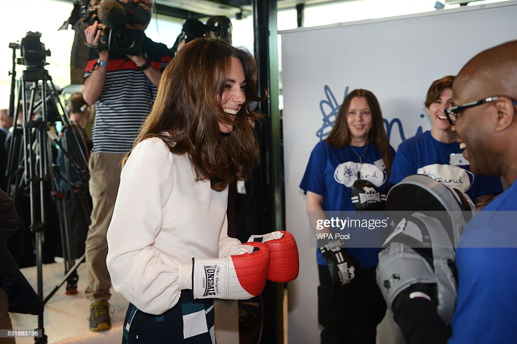 Catherine, Duchess of Cambridge is seen boxing with Duke McKenzie at Queen Elizabeth Olympic Park during the launch of the Heads Together campaign on mental health on May 16, 2016 in London, England.