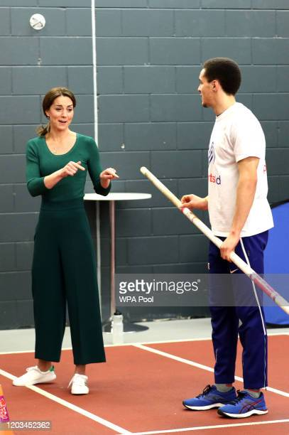 Catherine, Duchess of Cambridge is shown a pole vaulting pole during a SportsAid Stars event at the London Stadium in Stratford on February 26, 2020...