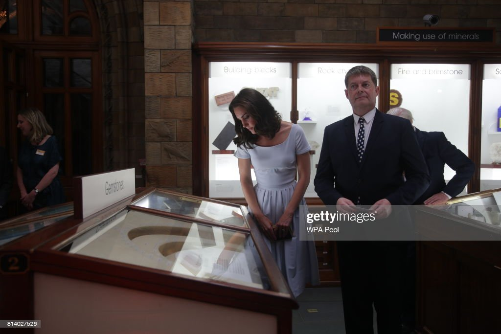 Catherine, Duchess of Cambridge is shown an exhibit by museum director Sir Michael Dixon as she attends the reopening of Hintze Hall at the Natural History Museum on July 13, 2017 in London, England..