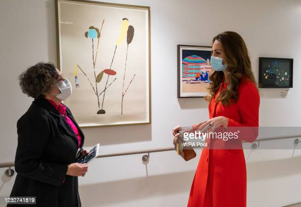 Catherine, Duchess of Cambridge is shown the artwork on display by Director of Vital Arts for Barts Health NHS Trust, Catsou Roberts, during a visit...
