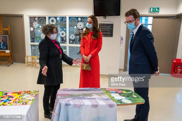 Catherine, Duchess of Cambridge is shown the artwork on display by Director of Vital Arts for Barts Health NHS Trust, Catsou Roberts and Director of...