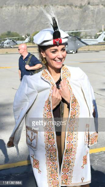 Catherine, Duchess of Cambridge is welcomed as the Duke and Duchess arrive by helicopter on October 16, 2019 in Chitral, Pakistan.
