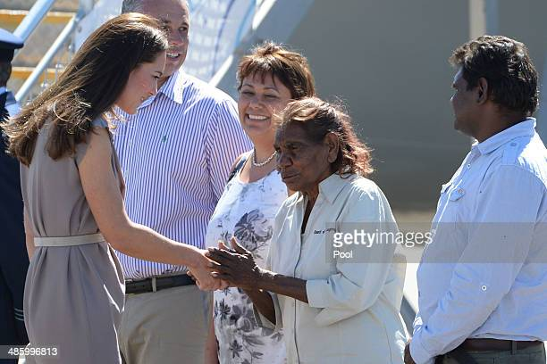 Catherine Duchess of Cambridge is welcomed by traditional owners Daisy Walkabout and Vincent Nipper as she and Prince William Duke of Cambridge...