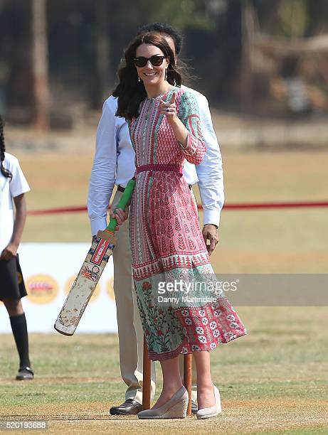Catherine, Duchess of Cambridge join a local cricket game during a visit to meet children from Magic Bus, Childline and Doorstep, three...