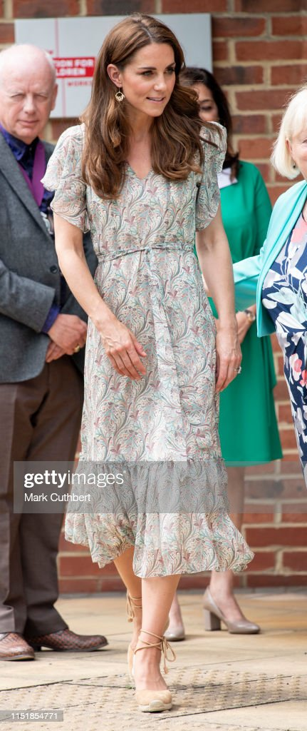 The Duchess Of Cambridge Joins Photography Workshop With Action For Children : News Photo
