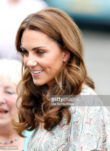Catherine Duchess of Cambridge joins a photography workshop for Action for Children run by the Royal Photographic Society at Warren Park on June 25...