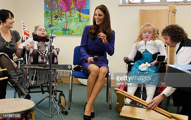 Catherine Duchess of Cambridge joins in a music class during a visit to open The Treehouse Children's Hospice on March 19 2012 in Ipswich England