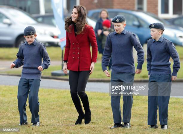 Catherine, Duchess of Cambridge joins in with a team building exercise during a visit to RAF Wittering to meet air cadets taking part in a half-term...