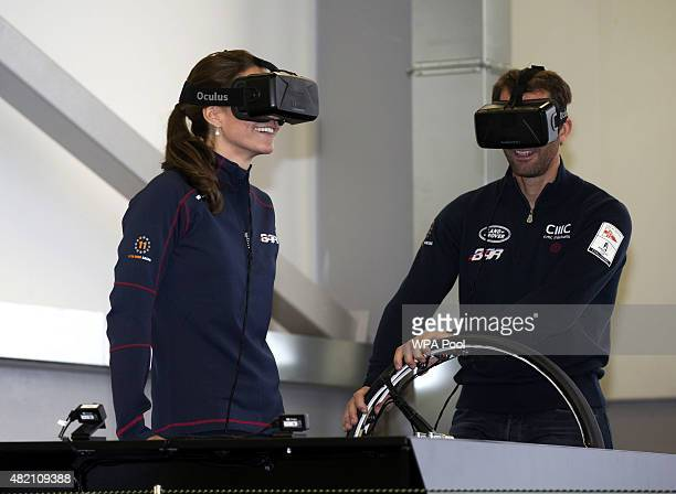 Catherine Duchess of Cambridge joins Sir Ben Ainslie on a sailing simulator during a visit to the headquarters of Britain's Land Roverbacked BAR team...
