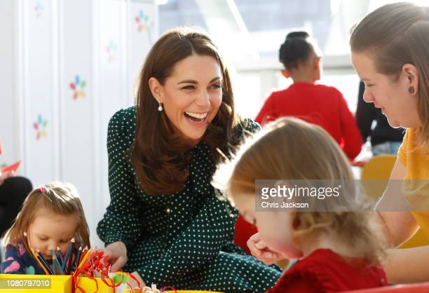 Catherine Duchess of Cambridge joins some of the children as they take part in Christmasthemed activities during a visit to Evelina London Children's...