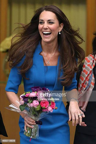 Catherine Duchess of Cambridge jokes with staff as she leaves the opening of the ICAP Art Room at Northolt High School on February 14 2014 in Ealing...
