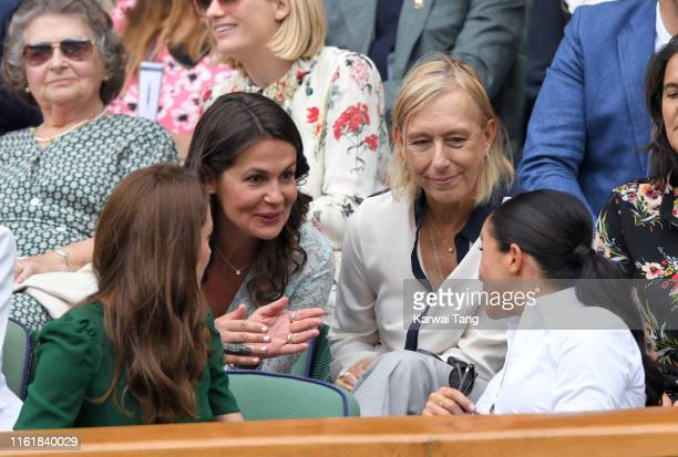 Catherine Duchess of Cambridge Julia Lemigova Martina Navratilova and Meghan Duchess of Sussex in the Royal Box on Centre Court during day twelve of...