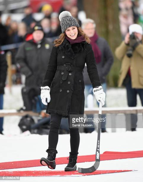 Catherine Duchess of Cambridge laughs as she attends a Bandy hockey match with Prince William Duke of Cambridge where they will learn more about the...