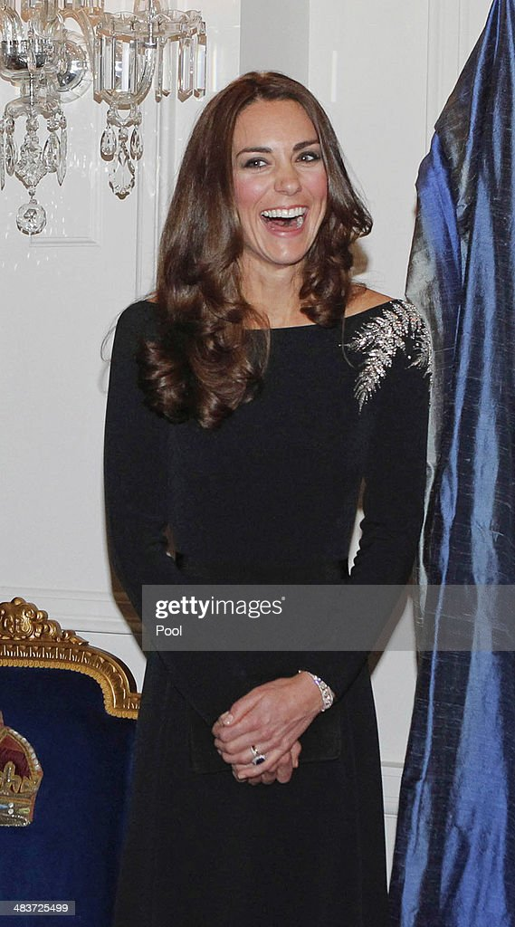 Catherine, Duchess of Cambridge laughs as she attends an art unveiling during Day 4 of a Royal Tour to New Zealand at Government House on April 10, 2014 in Wellington, New Zealand. The Duke and Duchess of Cambridge are on a three-week tour of Australia and New Zealand, the first official trip overseas with their son, Prince George of Cambridge.
