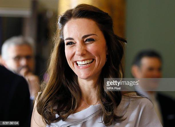 Catherine, Duchess of Cambridge laughs as she speaks with guests during a reception in support of The Anna Freud Centre on May 4, 2016 at Spencer...