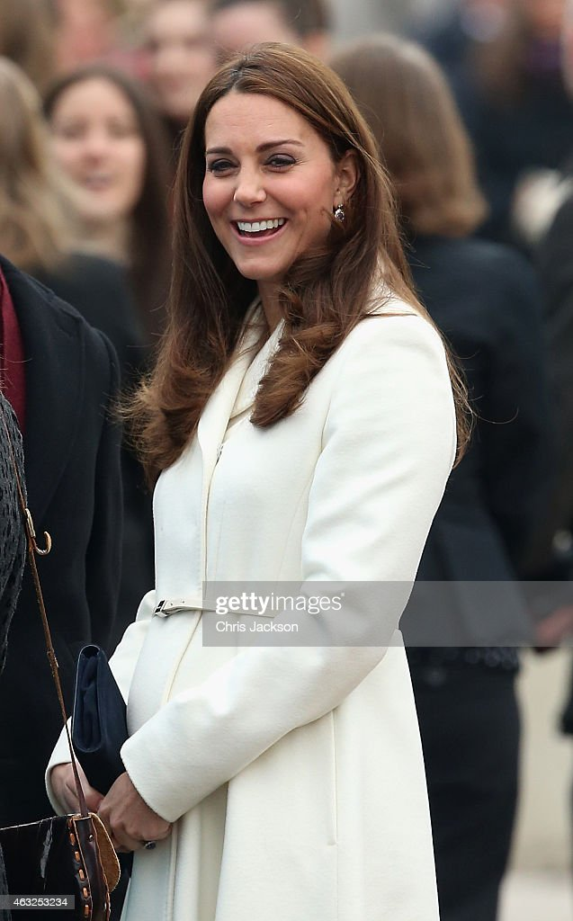 Catherine, Duchess of Cambridge laughs as she visits the home of Ben Ainslie Racing (BAR) in Portsmouth Old Town on February 12, 2015 in Portsmouth, England.