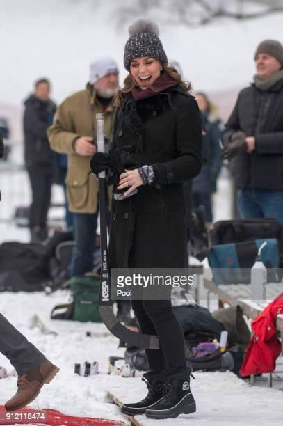 Catherine Duchess of Cambridge laughs as she visits the Stockholm bandy team Hammarby IF where they will learn more about the popularity of the sport...