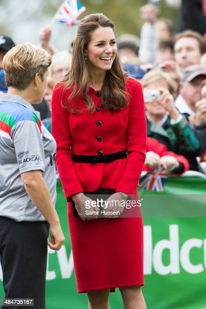 Catherine Duchess of Cambridge laughs at Prince William Duke of Cambridge during a game of cricket in Latimer Square on April 14 2014 in Christchurch...