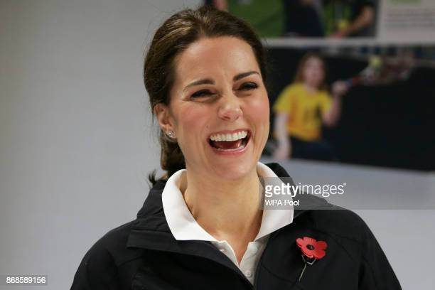 Catherine Duchess of Cambridge laughs during a briefing on a visit to the Lawn Tennis Association at the National Tennis Centre on October 31 2017 in...