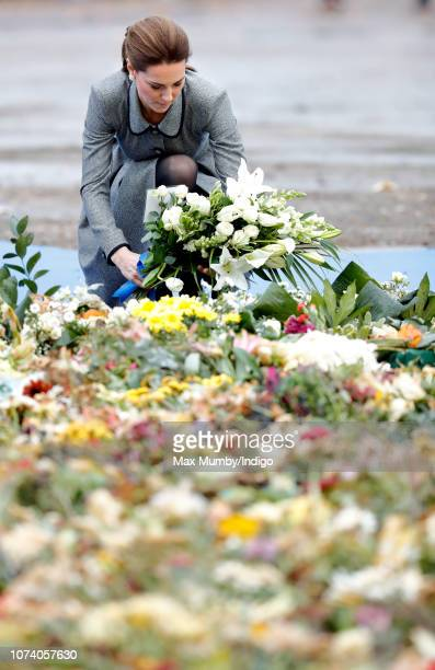 Catherine Duchess of Cambridge lays flowers as she visits the tribute site adjacent to Leicester City Football Club's King Power Stadium to pay her...