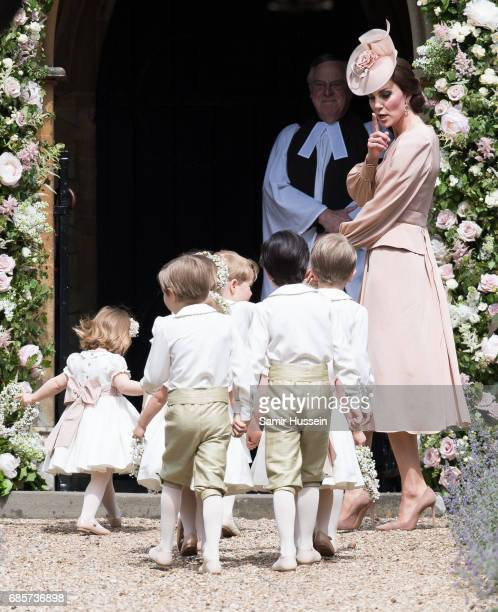 Catherine, Duchess of Cambridge leads the page boys and flower girls as they arrive for the wedding Of Pippa Middleton and James Matthews at St...