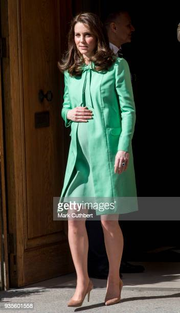 Catherine Duchess of Cambridge leaves after convening an early intervention for children and families symposium at Royal Society of Medicine on March...