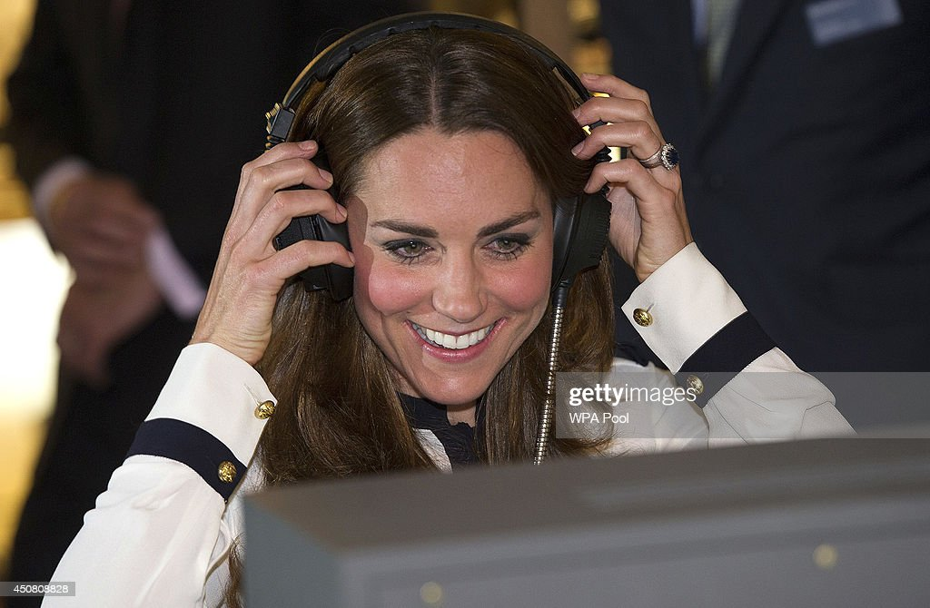 Catherine, Duchess Of Cambridge listens to a morse code message using a replica radio during a tour the of the restored WWII Codebreaking Huts at Bletchley Park on June 18, 2014 in Bletchley, England. The pre-fabricated wooden huts that housed the secret Government code breaking school during WWII, where encrypted messages sent by the Navy, Army and Air Forces of Germany and its allies were decrypted, translated and analysed for vital intelligence, have undergone a year long restoration.