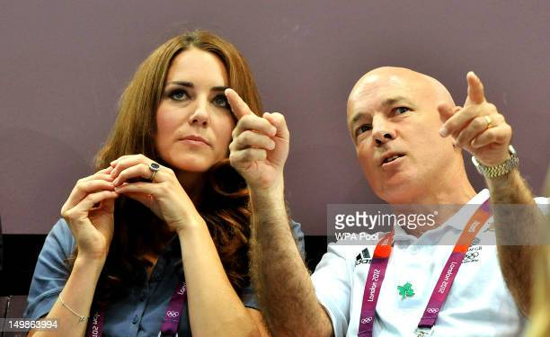 Catherine Duchess of Cambridge listens to John Brewer chairman of the British Handball Association during the Women's Handball Preliminaries Group A...