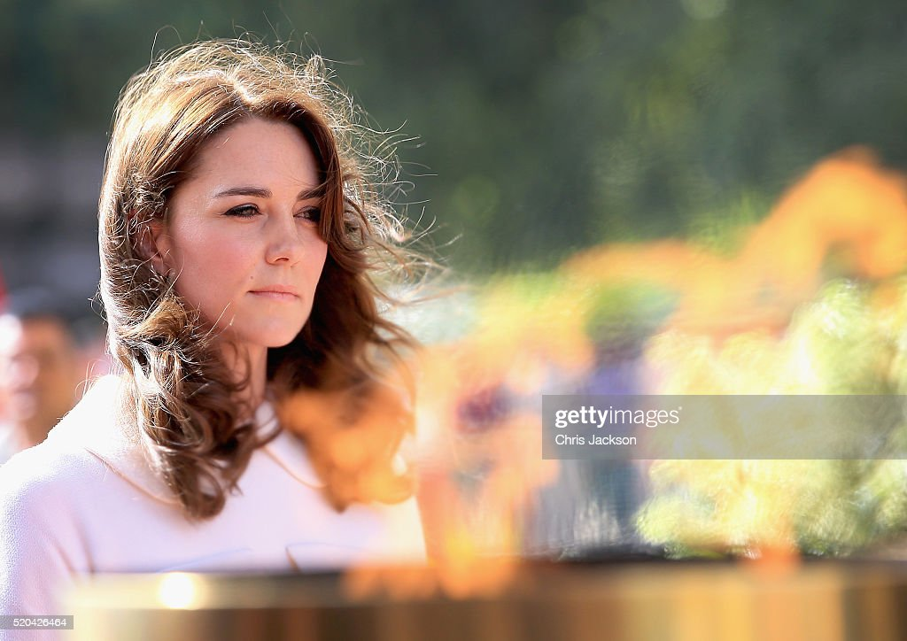 Catherine, Duchess of Cambridge looks at the flames of India Gate Memorial after laying a wreath at India Gate Memorial on day 2 of the royal visit to India and Bhutan on April 11, 2016 in Delhi, India. The Duke and Duchess of Cambridge are on a week-long tour of India and Bhutan taking in Mumbai, Delhi, Assam, Bhutan and Agra.