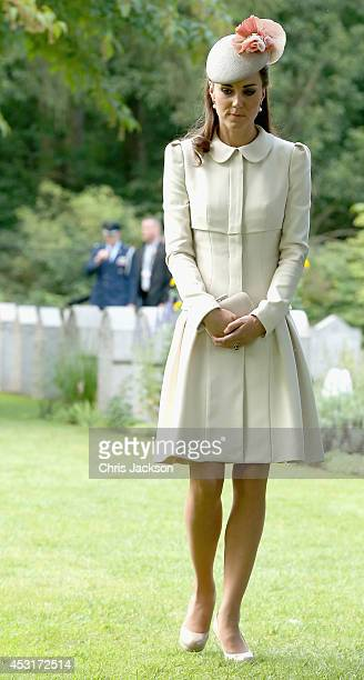 Catherine, Duchess of Cambridge looks at war graves at St Symphorien Military Cemetery on August 4, 2014 in Mons, Belgium. Monday 4th August marks...