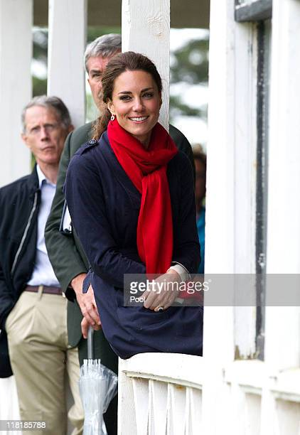 Catherine Duchess of Cambridge looks on as Prince William Duke of Cambridge takes part in helicopter manouvres called 'water birding' across Dalvay...