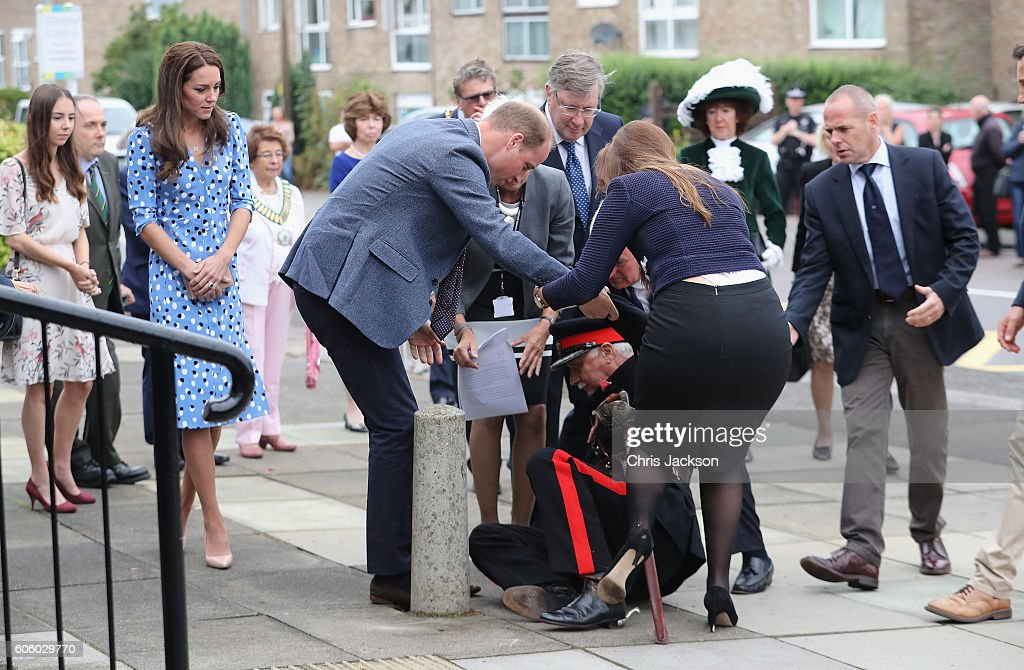 Catherine, Duchess of Cambridge looks on as Prince William, Duke of Cambridge rushes to helpVice Lord Lieutenant of Essex Jonathon Douglas-Hughes who fell backwards over a bollard as they arrive at Steward's Academy on September 16, 2016 in Harlow, England. The Duke and Duchess of Cambridge are visiting Steward's Academy as part of their Heads Together campaign, The Duke and Duchess of Cambridge will visit Stewards Academy in Harlow, Essex, to find out more about the pressures faced by young people when they are going through big changes in their lives, and learn about the support from peers and parents that can help them get through these changes.