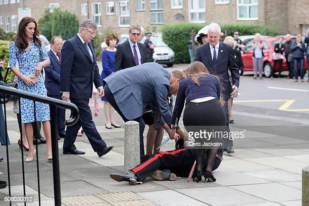 Catherine Duchess of Cambridge looks on as Prince William Duke of Cambridge helps Vice Lord Lieutenant of Essex Jonathan DouglasHughes who fell...