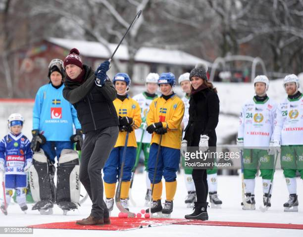 Catherine Duchess of Cambridge looks on as Prince William Duke of Cambridge plays Bandy hockey during day one of their Royal visit to Sweden and...